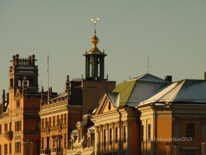 Stockholm City Hall and it's golden crowns seen behind the facades of Norrmalm near Strömmen (the Stream)